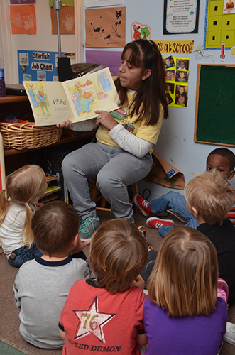 Little kids listening during story time